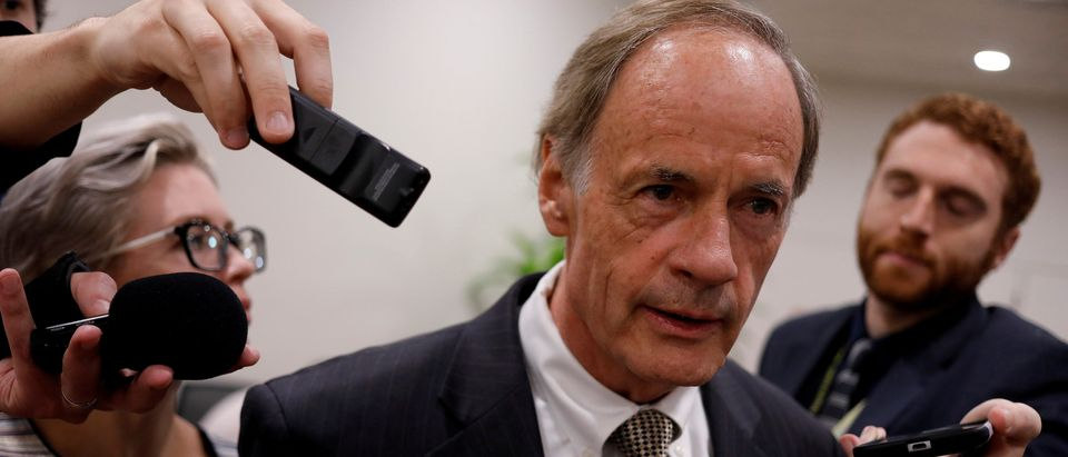 FILE PHOTO: Senator Tom Carper (D-DE) speaks to reporters ahead of the weekly party luncheons on Capitol Hill in Washington, U.S., August 1, 2017. REUTERS/Aaron P. Bernstein