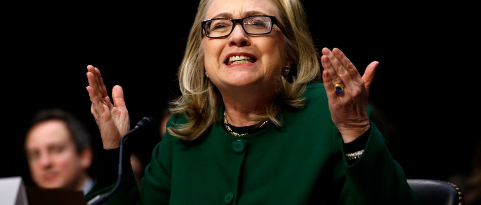 U.S. Secretary of State Clinton reacts while testifying on the Benghazi attacks during Senate Foreign Relations Committee hearing in Washington