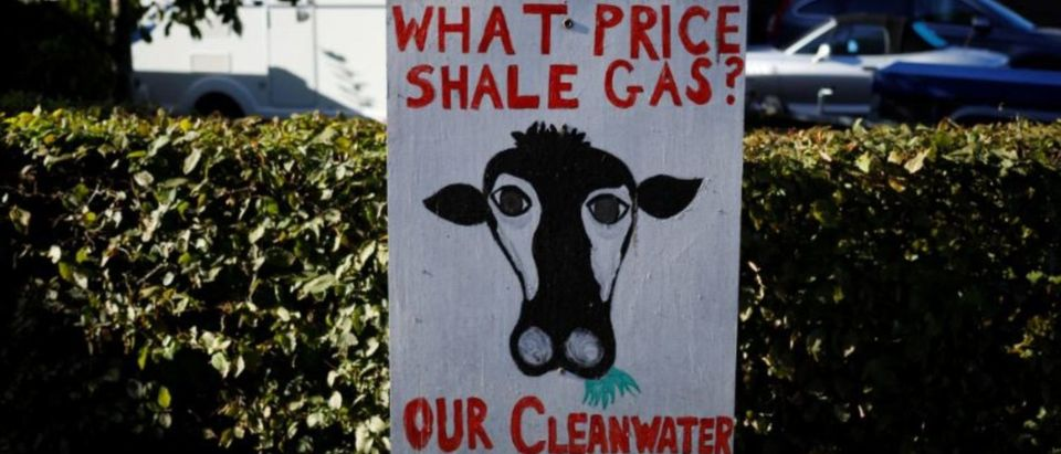 An anti-fracking sign stands near a farm in the village of Roseacre, northern England, Oct. 6, 2016. REUTERS/Phil Noble