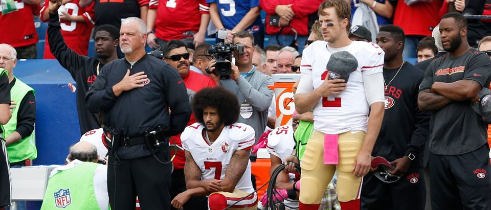 Oct 16, 2016; Orchard Park, NY, USA; San Francisco 49ers quarterback Colin Kaepernick (7) and quarterback Blaine Gabbert (2) react before a game against the Buffalo Bills at New Era Field. Mandatory Credit: Timothy T. Ludwig