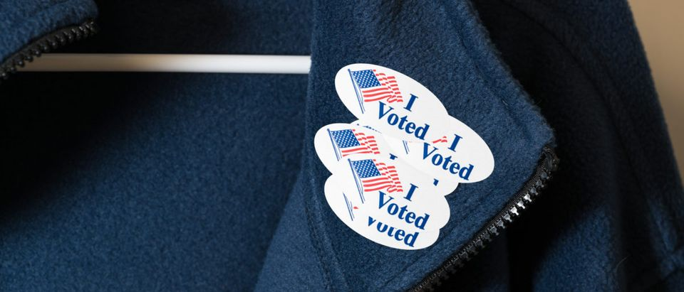 "A jacket sports multiple ""I Voted"" stickers. Shutterstock image via user Steve Heap"