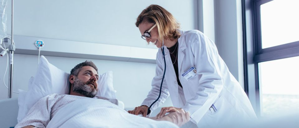 A man is treated at a hospital. Shutterstock image via user Jacob Lund