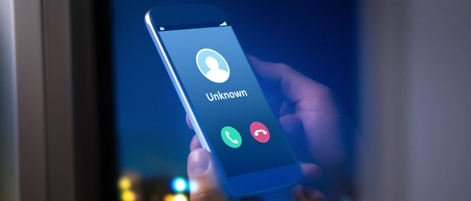 An unknown number rings through on a cellphone. Shutterstock image via user Tero Vesalainen