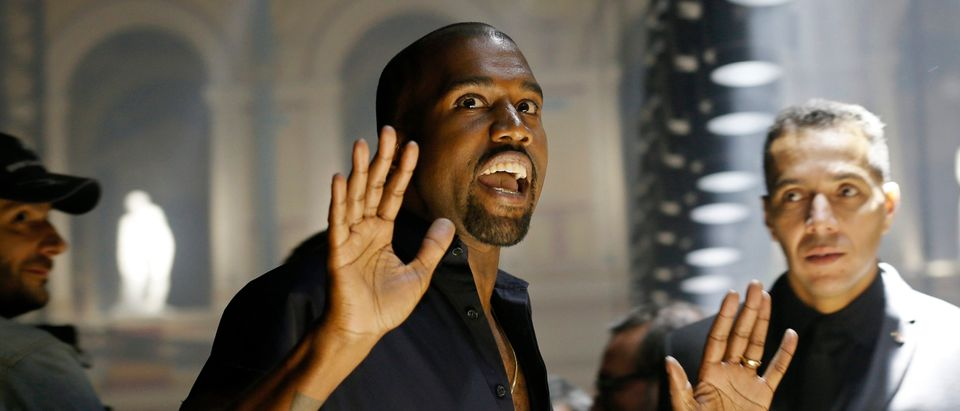 Rapper Kanye West reacts as he arrives to attend the Israeli-American designer Alber Elbaz Spring/Summer 2015 women's ready-to-wear collection for fashion house Lanvin during Paris Fashion Week September 25, 2014. REUTERS/Gonzalo Fuentes