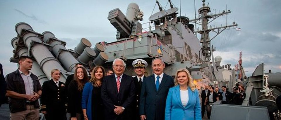 Israeli Prime Minister Benjamin Netanyahu (2nd R), his wife Sara (R), US Ambassador to Israel David Friedman (3rd L) and his wife Tami (2nd L) are pictured with the Commander of the USS Ross war ship David Coles (C) aboard the USS Ross, docked in the Israeli port of Ashdod, during a ceremony marking the 243rd birthday of the American warship, on October 11, 2018. (Photo by Heidi Levine / POOL / AFP) (Photo credit should read HEIDI LEVINE/AFP/Getty Images)