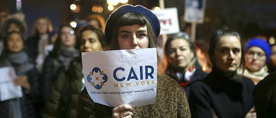 NEW YORK, UNITED STATES - JANUARY 25: Demonstrators hold banners during a rally against US President Donald Trump's order cracking down on immigrants in Washington Square Park in Manhattan borough of New York, USA on Jan. 25, 2017 as Council on American-Islamic Relations (CAIR) news conference continues. (Photo by Mohammed Elshamy/Anadolu Agency/Getty Images)