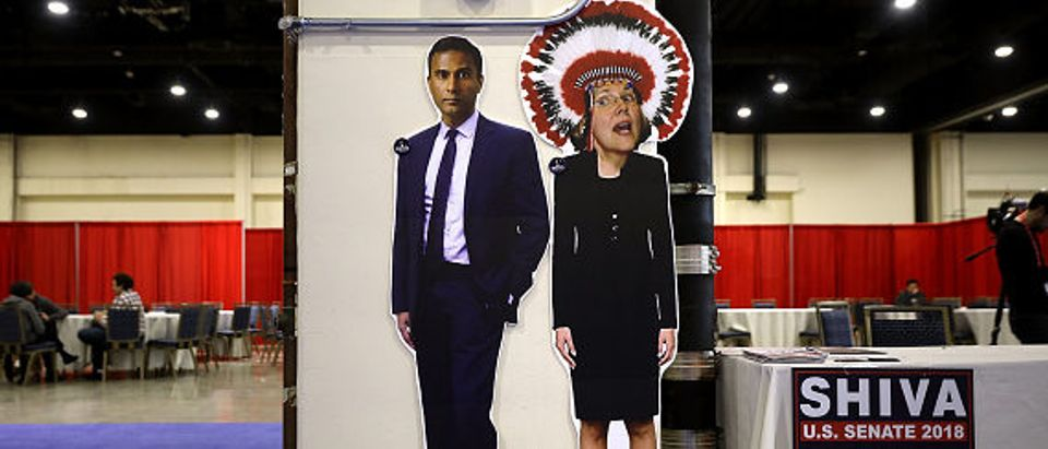 NATIONAL HARBOR, MD - FEBRUARY 23: A booth in support of Shiva Ayyadurai, who is running against Sen. Elizabeth Warren (D-MA), displays an 'Photoshopped' image of Warren wearing a Native American headdress inside the Conservative Political Action Conference Hub at the Gaylord National Resort and Convention Center February 23, 2018 in National Harbor, Maryland. Earlier in the day U.S. President Donald Trump addressed CPAC, the largest annual gathering of conservatives in the nation. (Photo by Chip Somodevilla/Getty Images)
