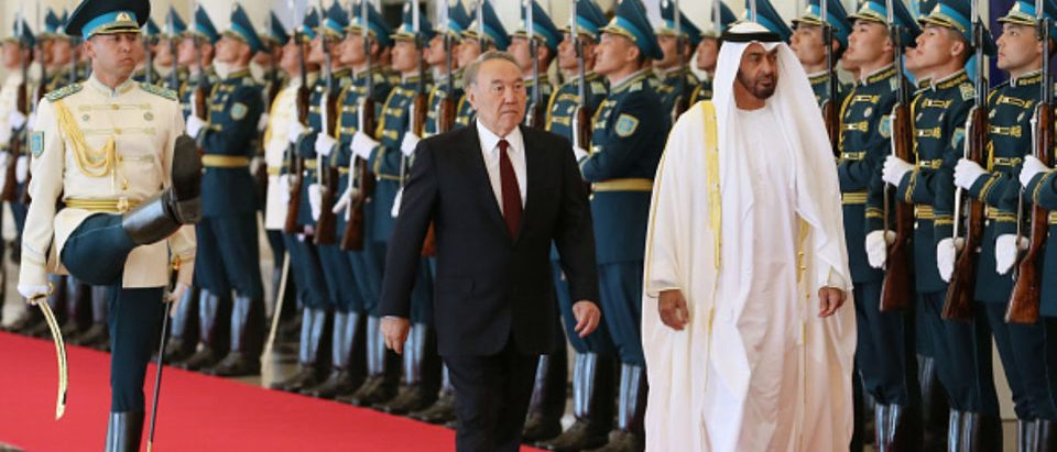 Abu Dhabi Crown Prince Mohammed bin Zayed al-Nahayan (R) reviews an honour guard with Kazakhstan's President Nursultan Nazarbayev during a welcoming ceremony in Astana on July 4, 2018