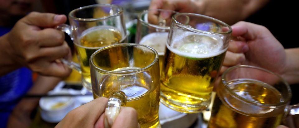 FILE PHOTO: People drink beer in a restaurant in Hanoi