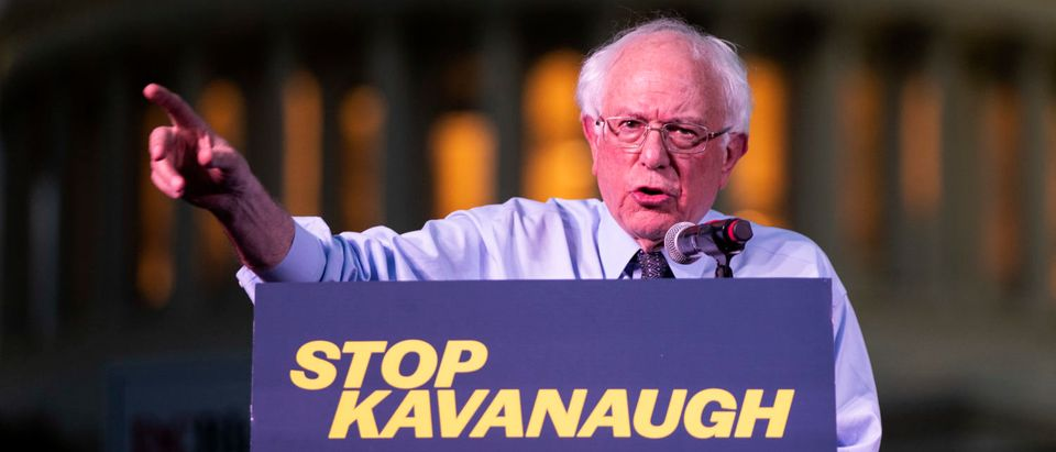 WASHINGTON, D.C. -- OCTOBER 4: U.S. Sen. Bernie Sanders (I-VT) speaks to protestors rallying against Supreme Court nominee Judge Brett Kavanaugh on Capitol Hill, October 4, 2018 in Washington, DC. Kavanaugh's confirmation process was halted for less than a week so that FBI investigators could look into allegations by Dr. Christine Blasey Ford, a California professor who who has accused Kavanaugh of sexually assaulting her during a party in 1982 when they were high school students in suburban Maryland. (Photo by Drew Angerer/Getty Images)
