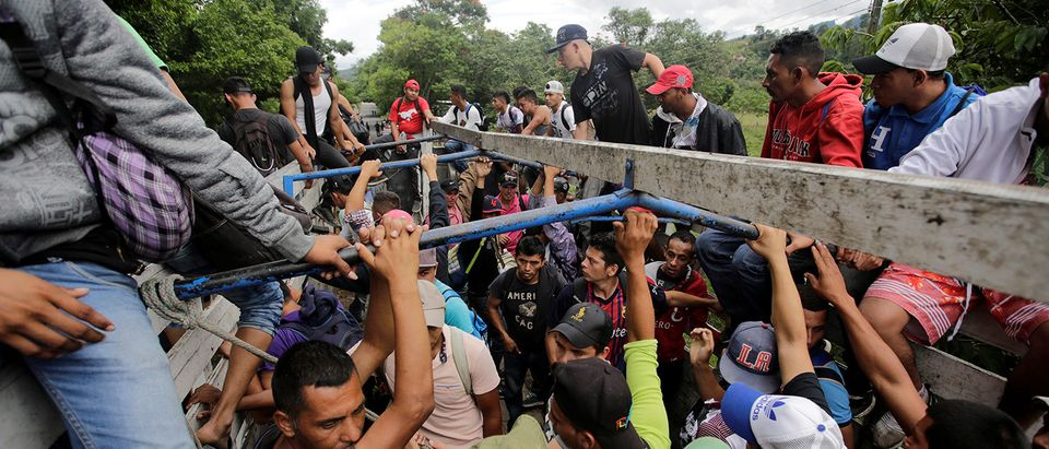 Honduran migrants board trucks sending them back to Honduras, after they crossed the border into Guatemala illegally in their bid to reach the U.S