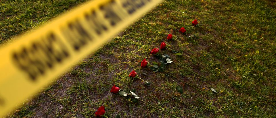 Ten roses are left in memory of the victims killed in a shooting at the Santa Fe High School in Santa Fe