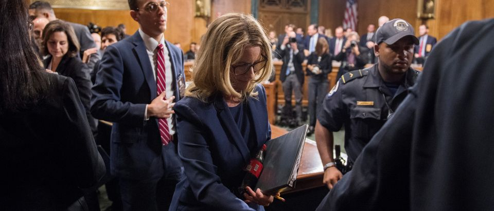 Christine Blasey Ford finishes testimony before the Senate Judiciary Committee hearing on the nomination of Brett M. Kavanaugh to be an associate justice of the Supreme Court of the United States, focusing on allegations of sexual assault by Kavanaugh against Christine Blasey Ford in the early 1980s, in Washington, D.C., September 27, 2018. Tom Williams/Pool via REUTERS