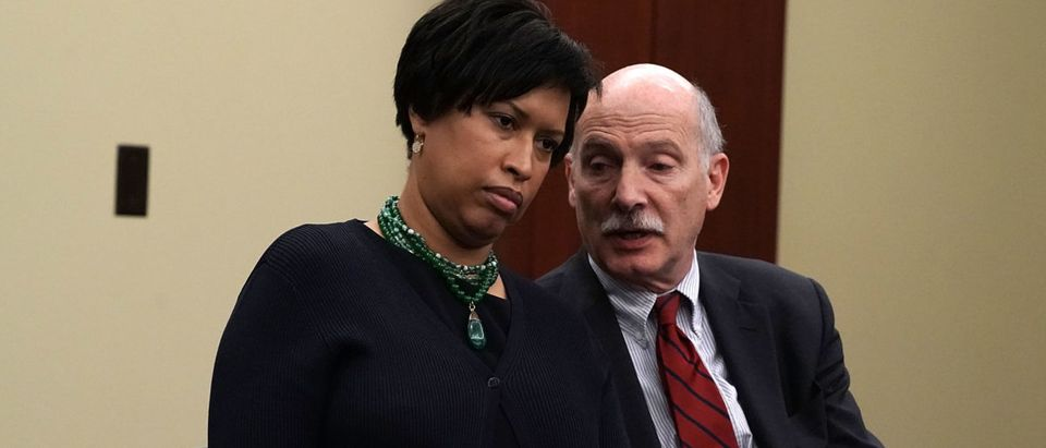"""WASHINGTON, D.C. - MAY 02: (L-R) Washington, D.C., Mayor Muriel Bowser and D.C. Council Chairman Phil Mendelson attend a news conference May 2, 2018 on Capitol Hill in Washington, DC. Del. Holmes Norton held a news conference to discuss """"efforts to protect D.C.'s local laws during the FY2019 appropriations process, including gun safety, anti-discrimination, labor, marijuana and abortion."""" (Photo by Alex Wong/Getty Images)"""