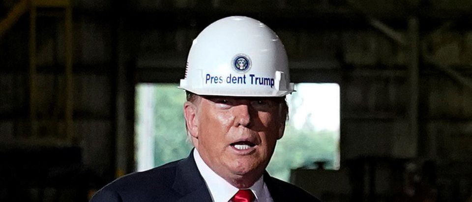 U.S. President Donald Trump wears a hardhat as he tours the Granite City Works hot strip steel mill in Granite City, Illinois