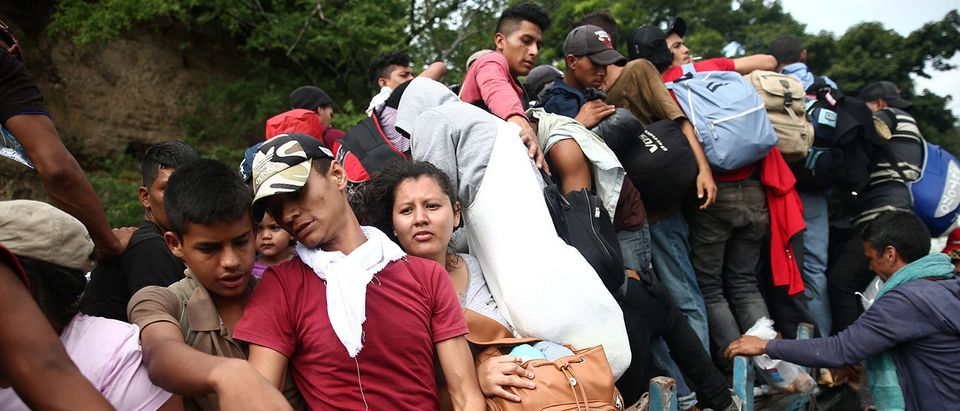 Honduran migrants, part of a caravan trying to reach the U.S., are pictured during a new leg of their travel in Chiquimula