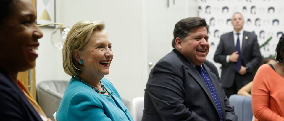 Former Secretary of State Hillary Clinton (C), Illinois gubernatorial candidate J.B. Pritzker (R) and Pritzker's Lieutenant Governor pick Juliana Stratton (L) speak during a round table discussion with high school students at a creative workspace for women on October 1, 2018 in Chicago, Illinois. Joshua Lott/Getty Images