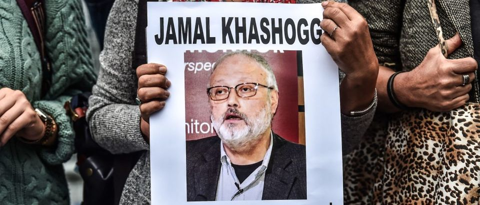 "A woman holds a portrait of missing journalist and Riyadh critic Jamal Khashoggi reading ""Jamal Khashoggi is missing since October 2"" during a demonstration in front of the Saudi Arabian consulate on October 9, 2018 in Istanbul. - Khashoggi, a Washington Post contributor, vanished last on October 2 after entering the Saudi Arabian consulate to receive official documents ahead of his marriage to a Turkish woman. A Turkish government source told AFP at the weekend that the police believe the journalist ""was killed by a team especially sent to Istanbul and who left the same day"". (Photo by OZAN KOSE / AFP)"