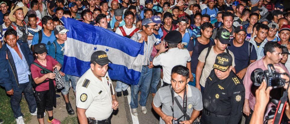 Honduran migrants taking part in a new caravan heading to the US, arrive to Chiquimula, Guatemala, on October 22, 2018. - US President Donald Trump on Monday called the migrant caravan heading toward the US-Mexico border a national emergency, saying he has alerted the US border patrol and military. (Photo by ORLANDO ESTRADA / AFP)
