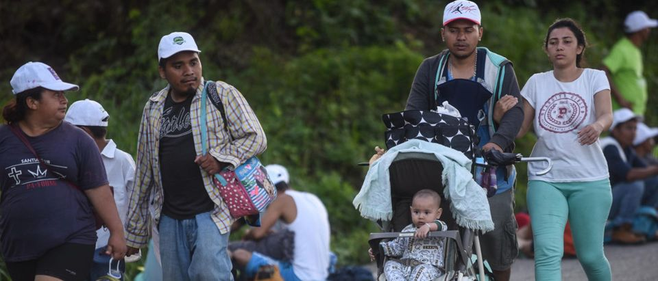 A Honduran migrant family heading in a caravan to the U.S., walk in Mapastepec on their way to Pijijiapan Chiapas state, Mexico, on Oct. 25, 2018. JOHAN ORDONEZ/AFP/Getty Images