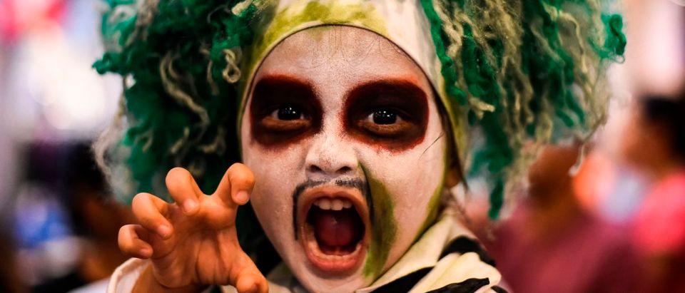 A boy wearing a costume poses for a photo during Halloween carnival at a shopping mall in Kuala Lumpur on October 27, 2018. MOHD RASFAN/AFP/Getty Images