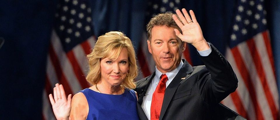 Senator Rand Paul (R-KY) greets the crowd with his wife, Kelley Paul prior to speaking to supporters during the kickoff of the National Stand with Rand tour on April 7, 2015 in Louisville, Kentucky. AFP PHOTO / MICHAEL B. THOMAS