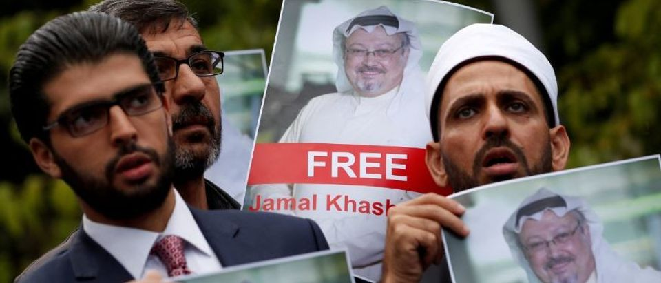 FILE PHOTO: Human rights activists and friends of Saudi journalist Jamal Khashoggi hold his pictures during a protest outside the Saudi Consulate in Istanbul, Turkey October 8, 2018. REUTERS/Murad Sezer/File Photo