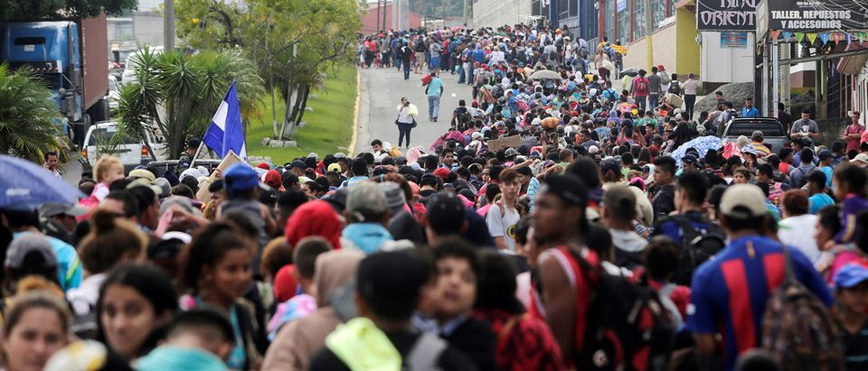 Thousands of Hondurans fleeing poverty and violence move in a caravan toward the United States, in Santa Rosa de Copan