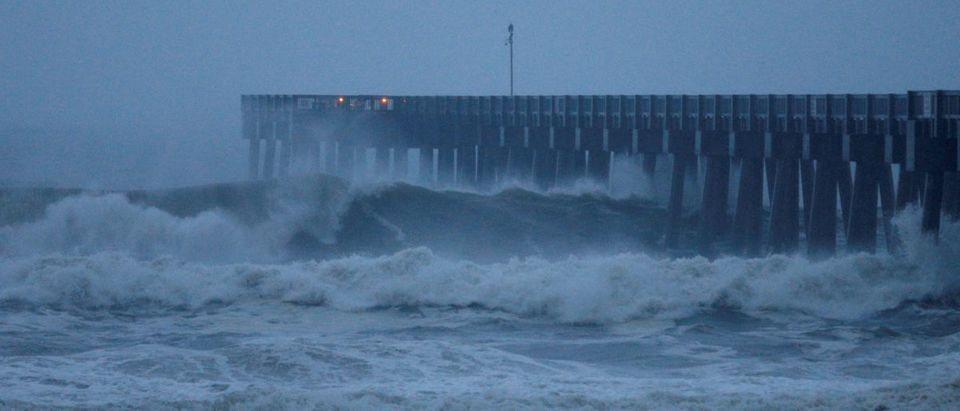 Waves crash along a pier as Hurricane Michael approaches Panama City Beach, Florida, U.S. October 10, 2018. REUTERS/Jonathan Bachman