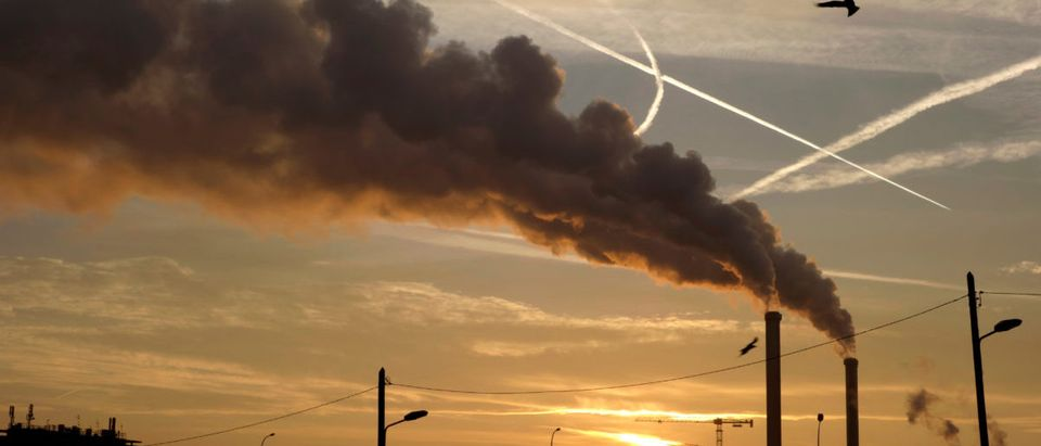 Water vapour billows from smokestacks at the incineration plant of Ivry-sur-Seine, near Paris at sunrise