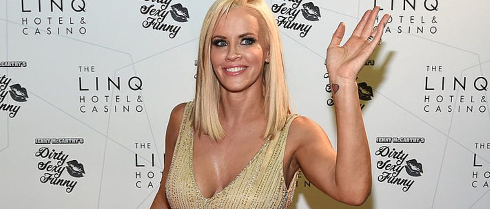 "Actress/comedian Jenny McCarthy waves as she arrives at The LINQ to promote her ""Dirty Sexy Funny"" comedy show on September 25, 2014 in Las Vegas, Nevada. The tour will kick off on September 26 at The Quad Resort Casino in Las Vegas. (Photo by Ethan Miller/Getty Images)"