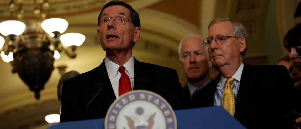 Sen. John Barrasso (R-WY), accompanied by Senate Majority Leader Mitch McConnell and Sen. John Cornyn (R-TX), speaks with the media following the weekly policy luncheons on Capitol Hill in Washington