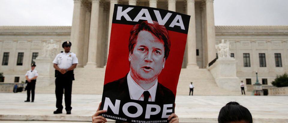 Protesters demonstrate on first day with newly sworn in Associate Justice Brett Kavanaugh on the court at the Supreme Court in Washington