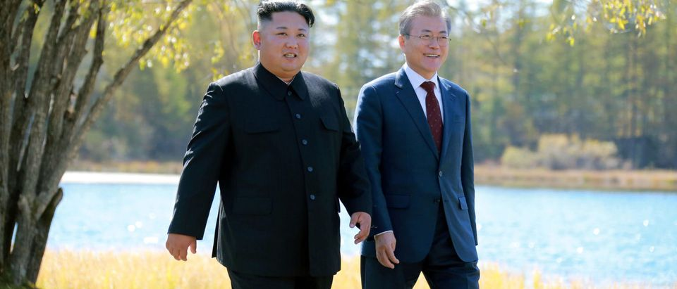 South Korean President Moon Jae-in and North Korean leader Kim Jong Un walk during a luncheon, in this photo released by North Korea's Korean Central News Agency (KCNA) on September 21, 2018. KCNA via REUTERS