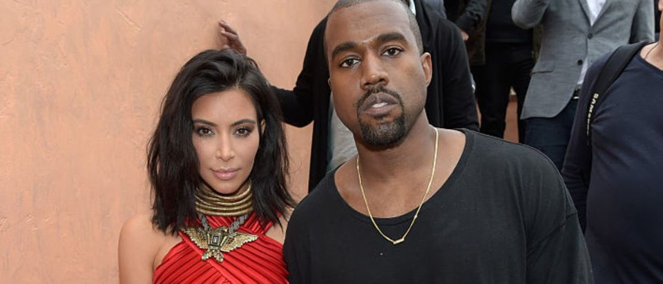 "TV personality Kim Kardashian and recording artist Kanye West, speculated to be wearing the Yeezy 3 sneakers ""Yeezy 750 Boost"", attend Roc Nation and Three Six Zero Pre-GRAMMY Brunch 2015 at Private Residence on February 7, 2015 in Beverly Hills, California. (Photo by Jason Kempin/Getty Images for PUMA)"