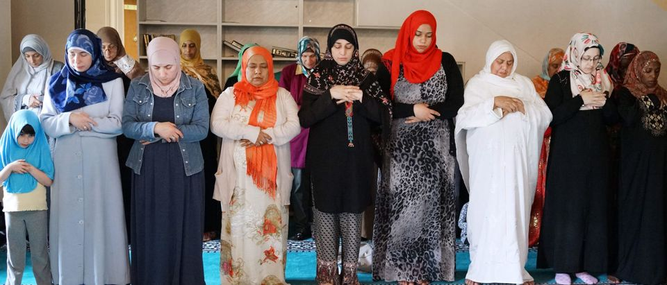 """Worshipers attend Friday afternoon prayers in the mosque at the Diyanet Center of America on May 13, 2016 in Lanham, Maryland. Sitting on a red and green carpet inside a mosque in a suburb of Washington, Nabill Abdulle describes an invisible force. You can't see it, he says, but """"it's there."""" Islamophobia haunts the Muslims of Lanham, Maryland -- 30 minutes north of the US capital -- as the country's divisive election campaign fuels fears already heightened by Islamic State group attacks in Brussels and Paris. (OLIVIER DOULIERY/AFP/Getty Images)"""