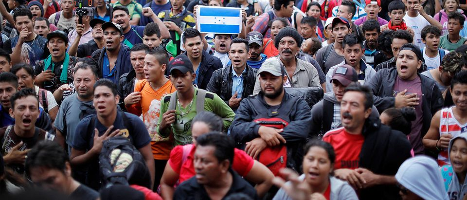 Honduran migrants, part of a caravan trying to reach the U.S., gather near the border with Mexico, in Tecun Uman
