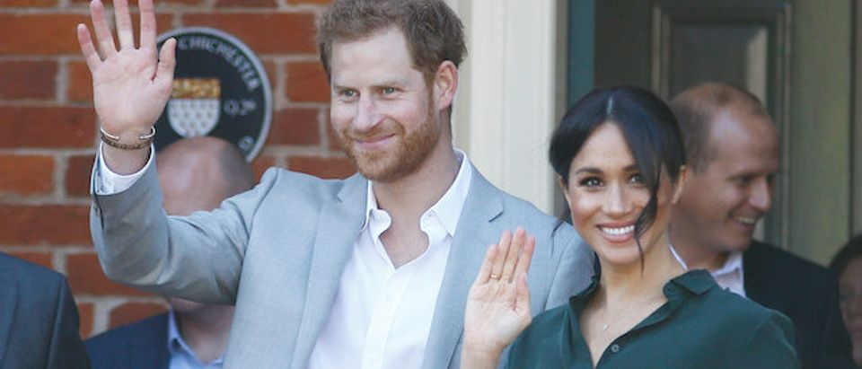 Prince Harry and his wife Meghan, the Duchess of Sussex, greet well wishers in Chichester