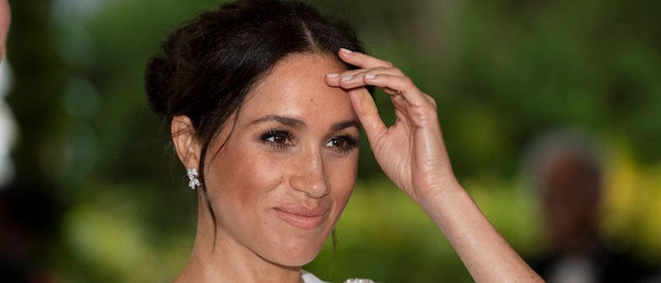 Meghan, Duchess of Sussex gestures as she attends a state dinner in Nuku'alofa, Tonga, October 25, 2018. Paul Edwards/Pool via REUTERS