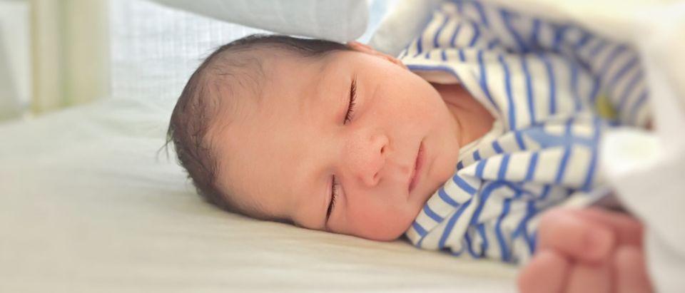 Newborn baby sleeping. Shutterstock/rarrarorro