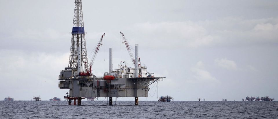 A view of a drilling rig and distant production platform in the Soldado Field off Trinidad's southwest coast