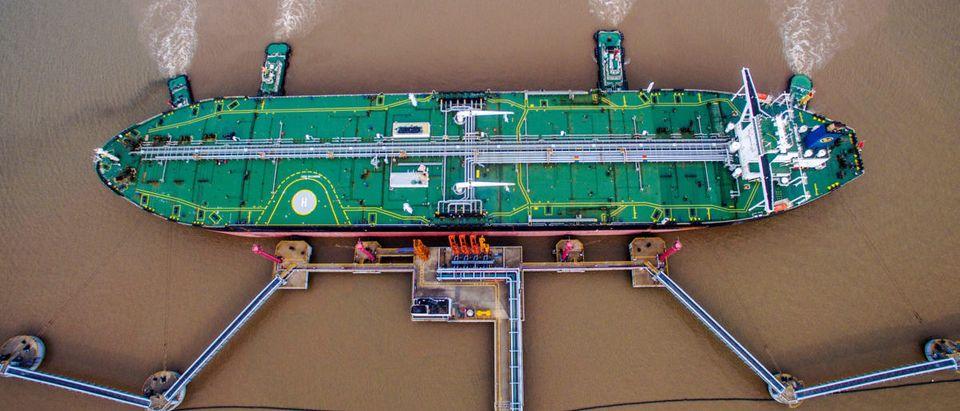 Oil tanker unloads crude oil at a crude oil terminal in Zhoushan