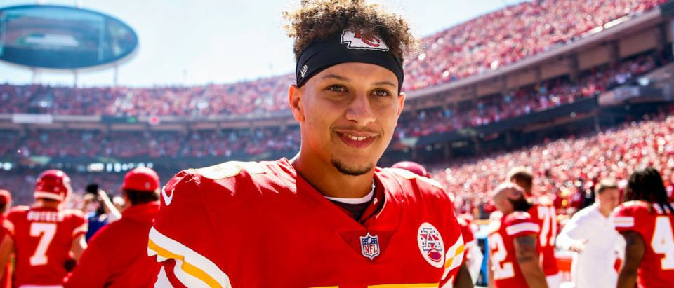 Patrick Mahomes #15 of the Kansas City Chiefs smiles on the sidelines before the start of the game against the San Francisco 49ers at Arrowhead Stadium on September 23rd, 2018 in Kansas City, Missouri. (Photo by David Eulitt/Getty Images)