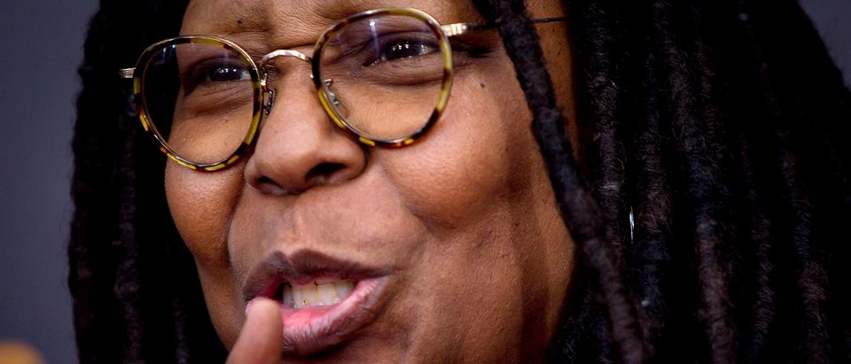 """TV personality Whoopi Goldberg tells the media to """"shhh"""" as she arrives for the premiere of """"The Imitation Game"""" in New York"""