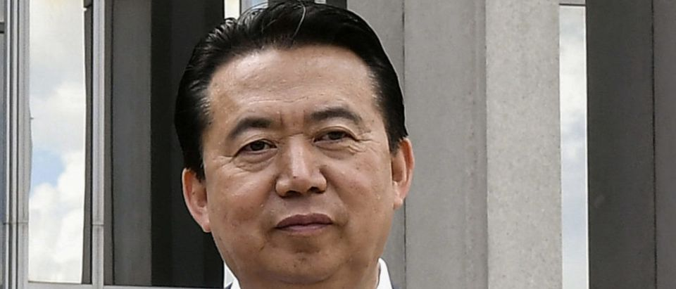 INTERPOL President Meng Hongwei poses during a visit to the headquarters of International Police Organisation in Lyon