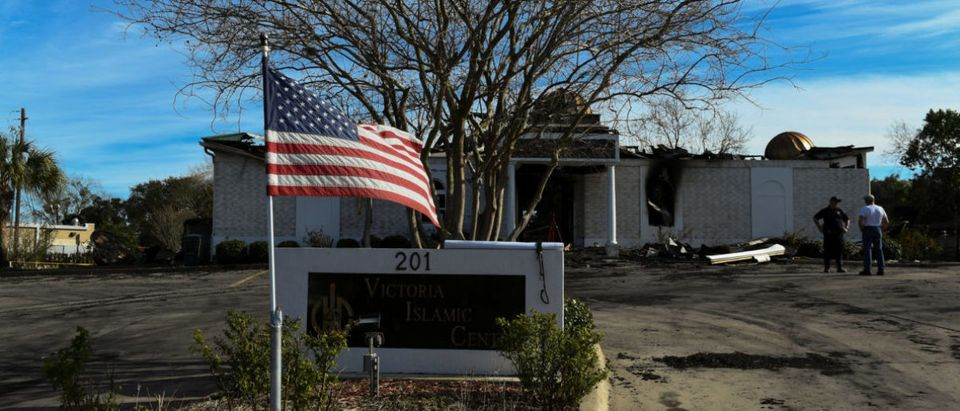 A U.S. flag flies outside the Victoria Islamic Center one day after the mosque was left damaged by a fire in Victoria, Texas
