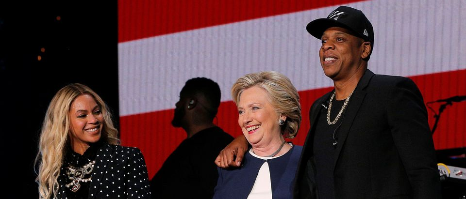 FILE PHOTO: U.S. Democratic presidential nominee Hillary Clinton joins Jay Z and Beyonce onstage at a campaign concert in Cleveland, Ohio, U.S. November 4, 2016. REUTERS/Brian Snyder