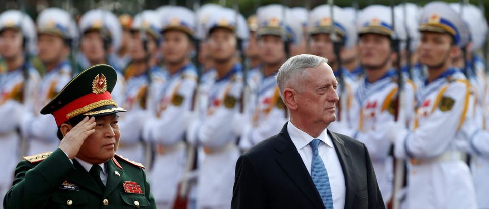 U.S. Secretary of Defense Jim Mattis (R) and Vietnam's Defence Minister Ngo Xuan Lich review the guard of honour during a welcoming ceremony in Hanoi, Vietnam January 25, 2018. REUTERS/Kham
