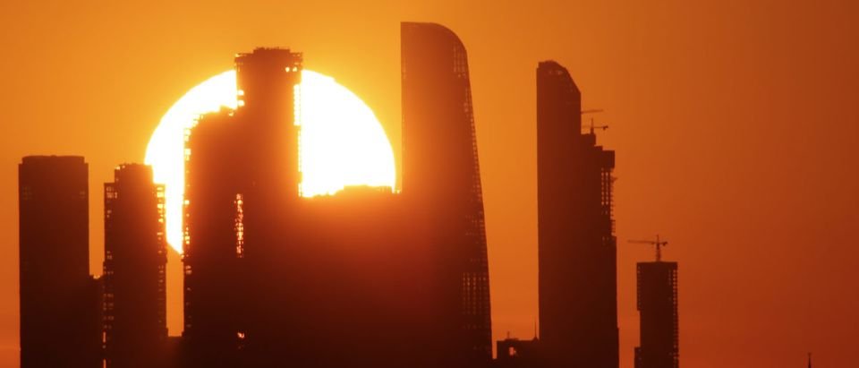 The sun sets behind the skyscrapers of the Moscow International Business Centre in Moscow