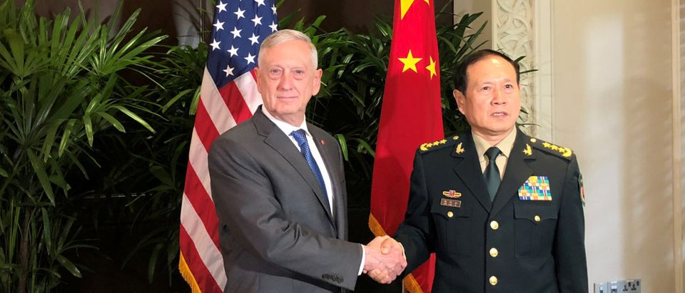 U.S. Defense Secretary Jim Mattis and China's Defense Minister Wei Fenghe greet each other ahead of talks in Singapore